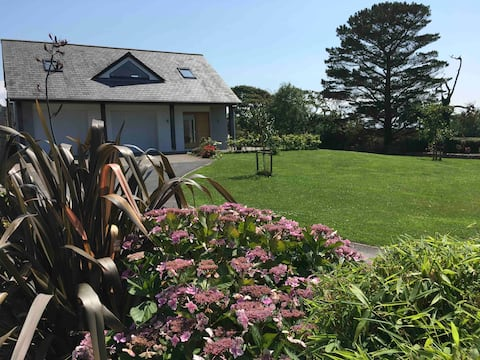 Spacious property set in meadow with sea views.