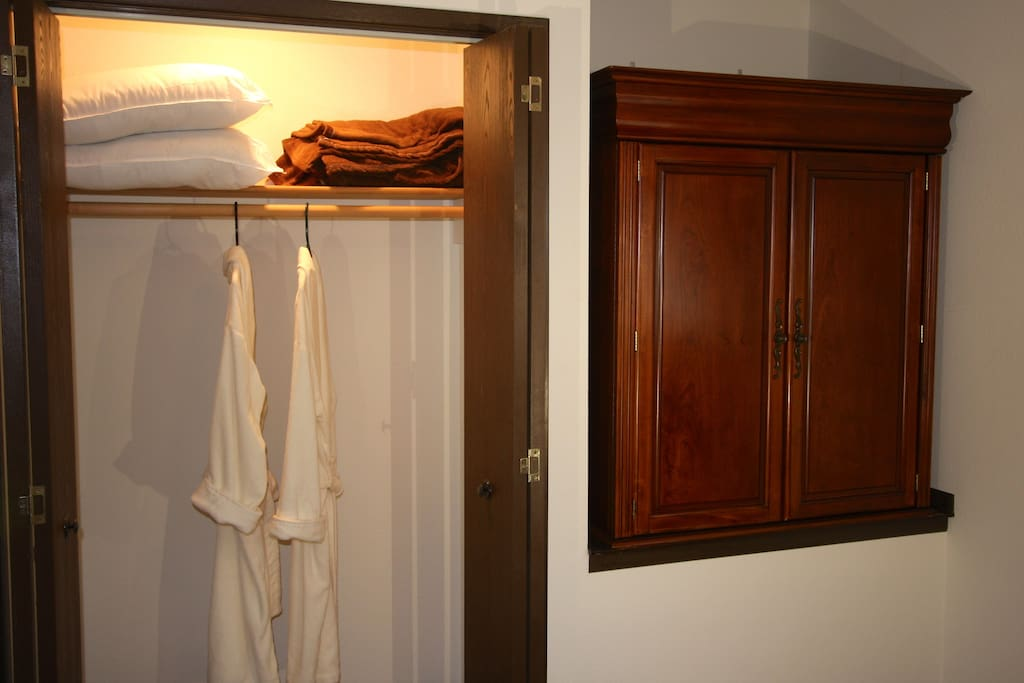 Besides extra pillows and a blanket, you will find plush robes for wearing to the hot tub