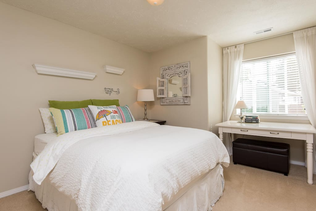 Our second guest room offers generous space and a desk for working if that is helpful.