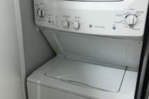Washer and dryer inside apartment.