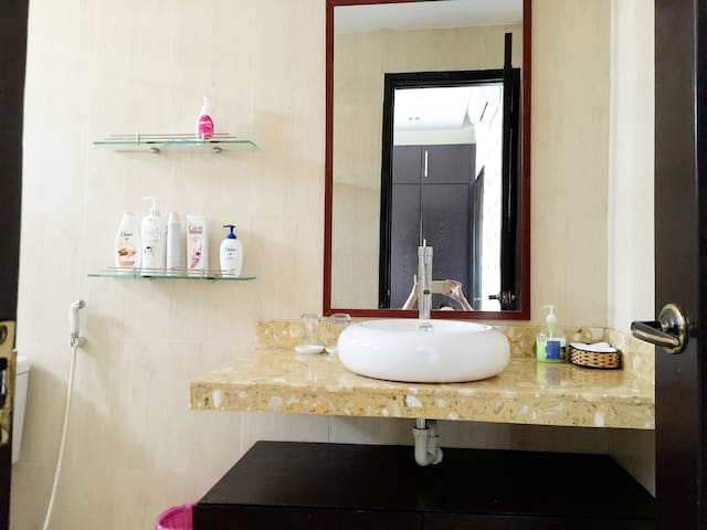 Private bathroom is prepared with shampoo, body soaps, hand soap and towels