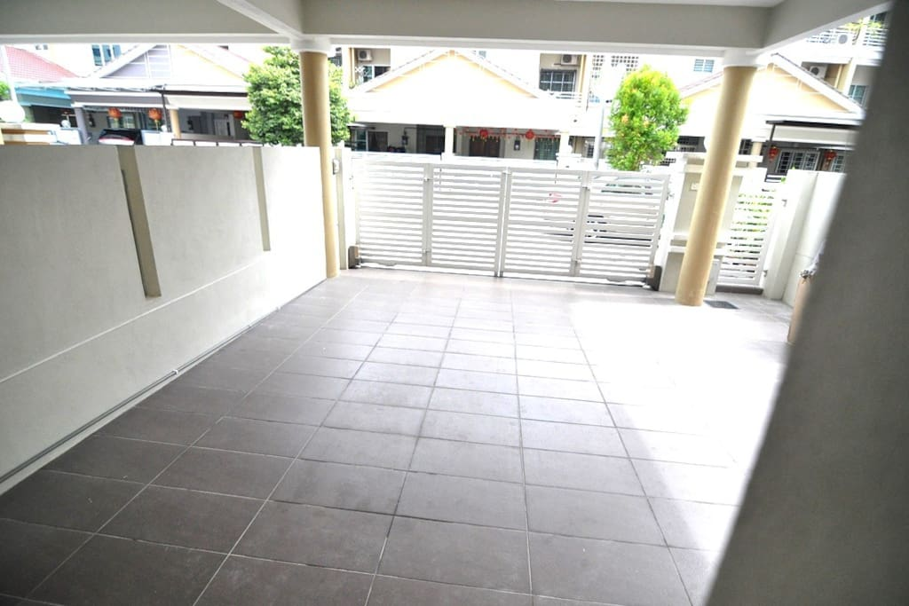 ample parking with autogate and small door entring.