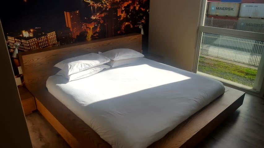 King Size Bed with soundproof bedroom windows for a peaceful night's sleep