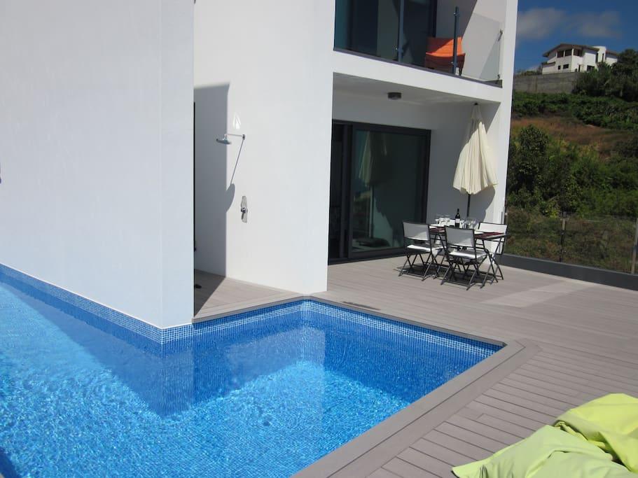 Sun, blue skies and blue Pool area