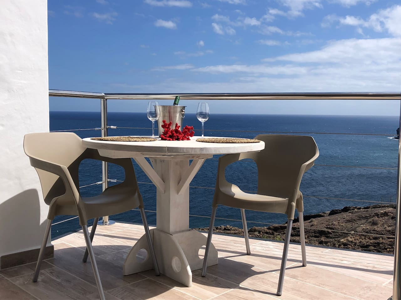 Have a glass of champagne on the spacious terrace and enjoy one of the most stunning views and sunsets of Las Playitas.