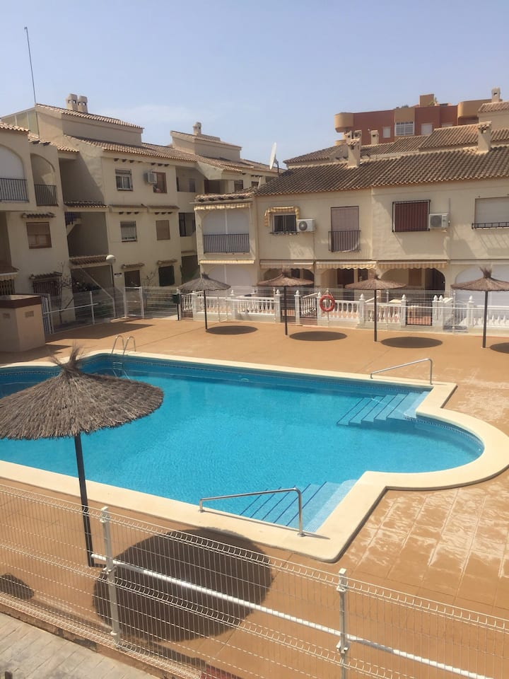 Two bed duplex short walk from beach com pool