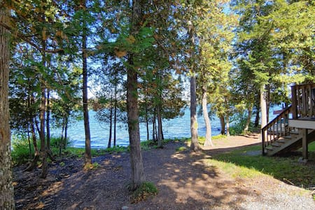 Cozy lakefront home w/ a firepit, outdoor shower, & private beach!