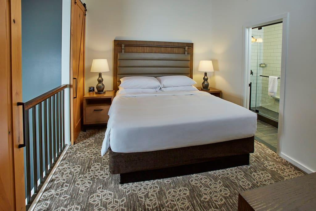 Lofted bedroom in the one-room villa.