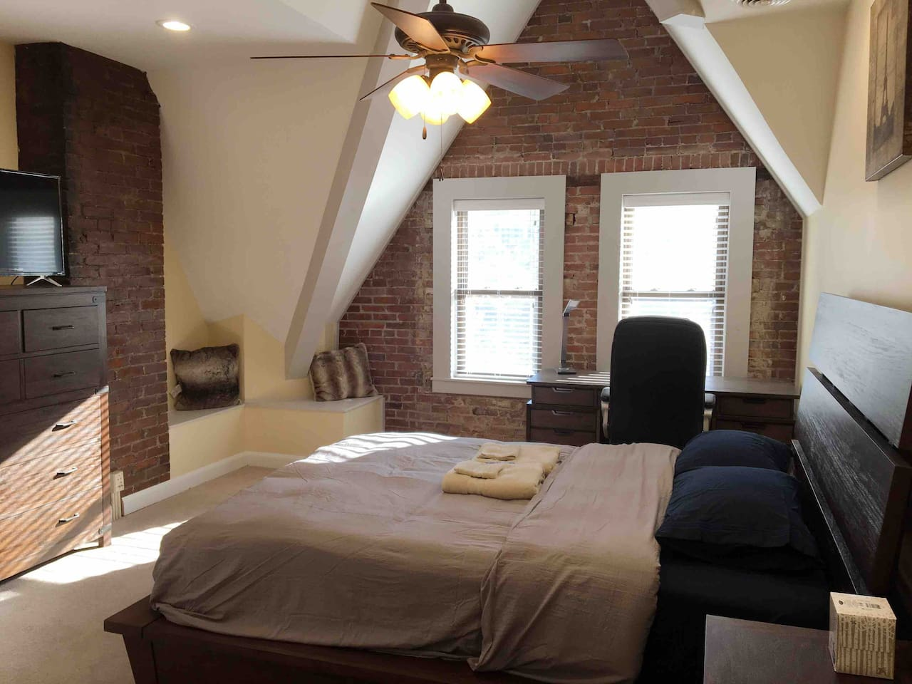 Brick room with queen size memory foam bed and a stylish 4 foot drop down ceiling