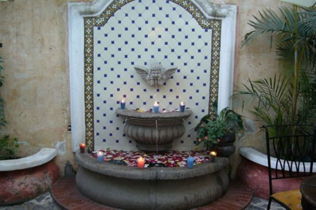 Fountain in front of the apartment private patio.