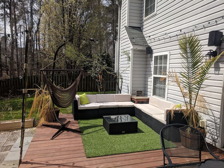 Back patio upgrade with comfy green grass, Bluetooth Pyle Audio, Lights