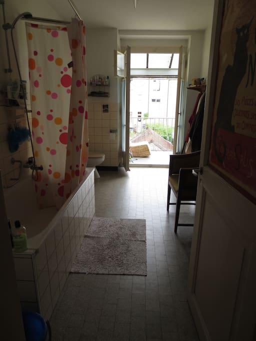 large bathroom with balcony