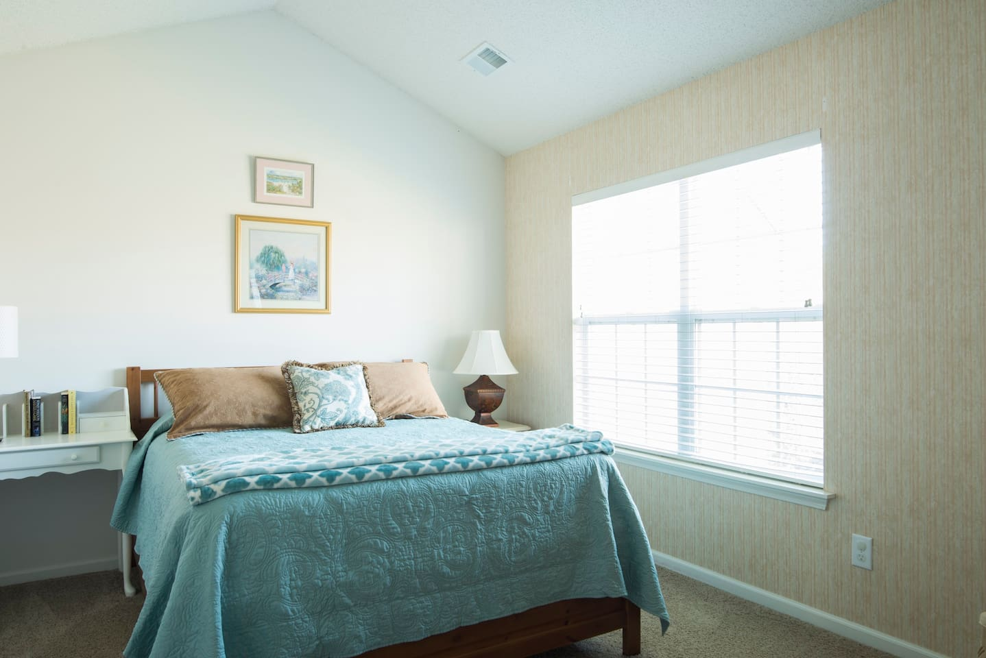 Clean Queen Size Bed with high ceilings