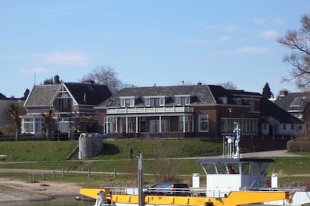 House overlooking the river IJssel