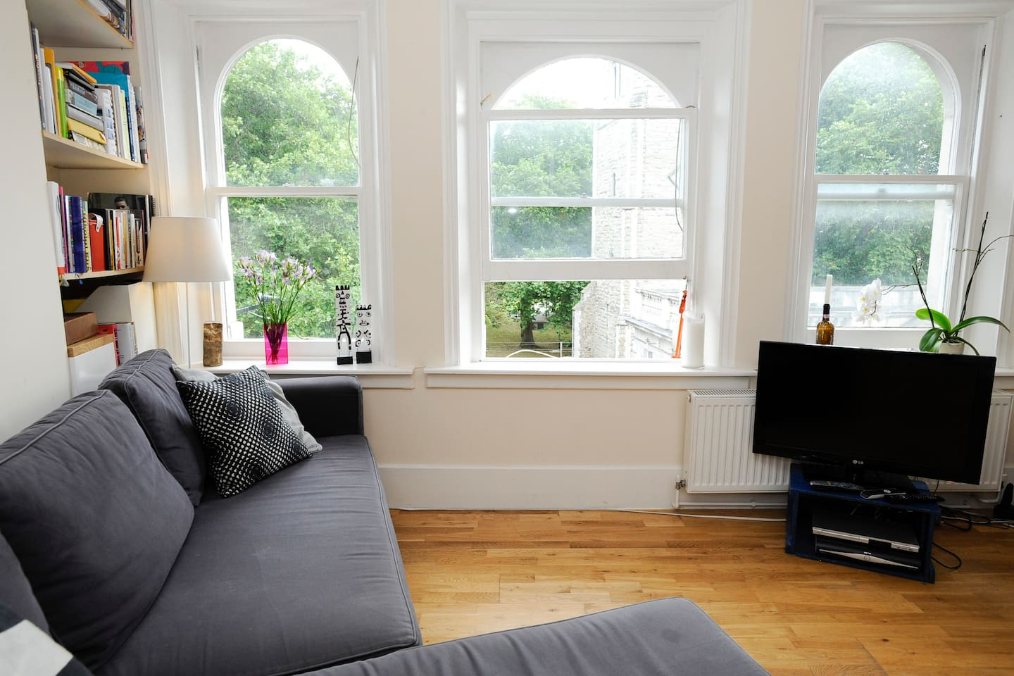 Living room with comfy sofa bed overlooking a cute little park