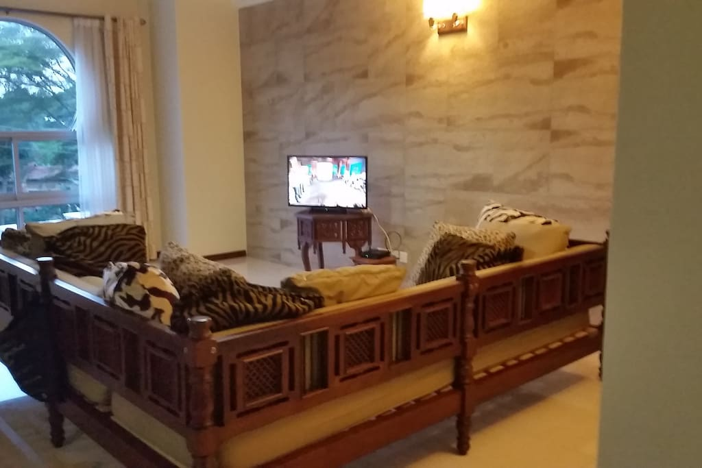 Share large sitting room with balcony overlooking the Lake Victoria