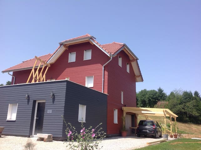 Canapé lit dans maison écologique - Grandfontaine  - Casa