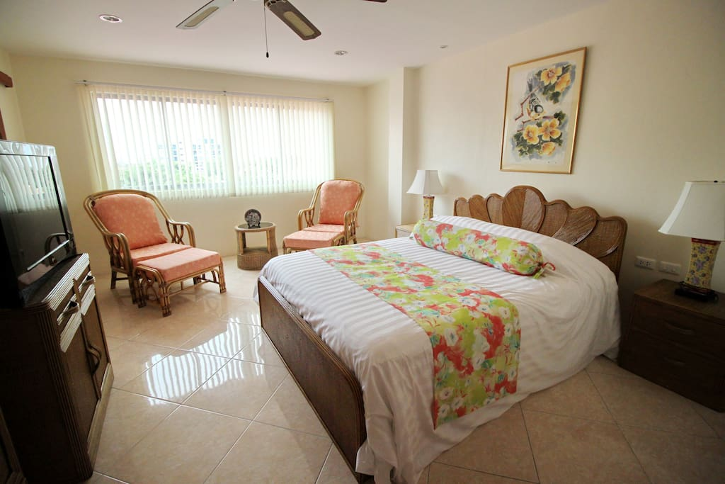 King size bedroom with sitting area and wardrobe