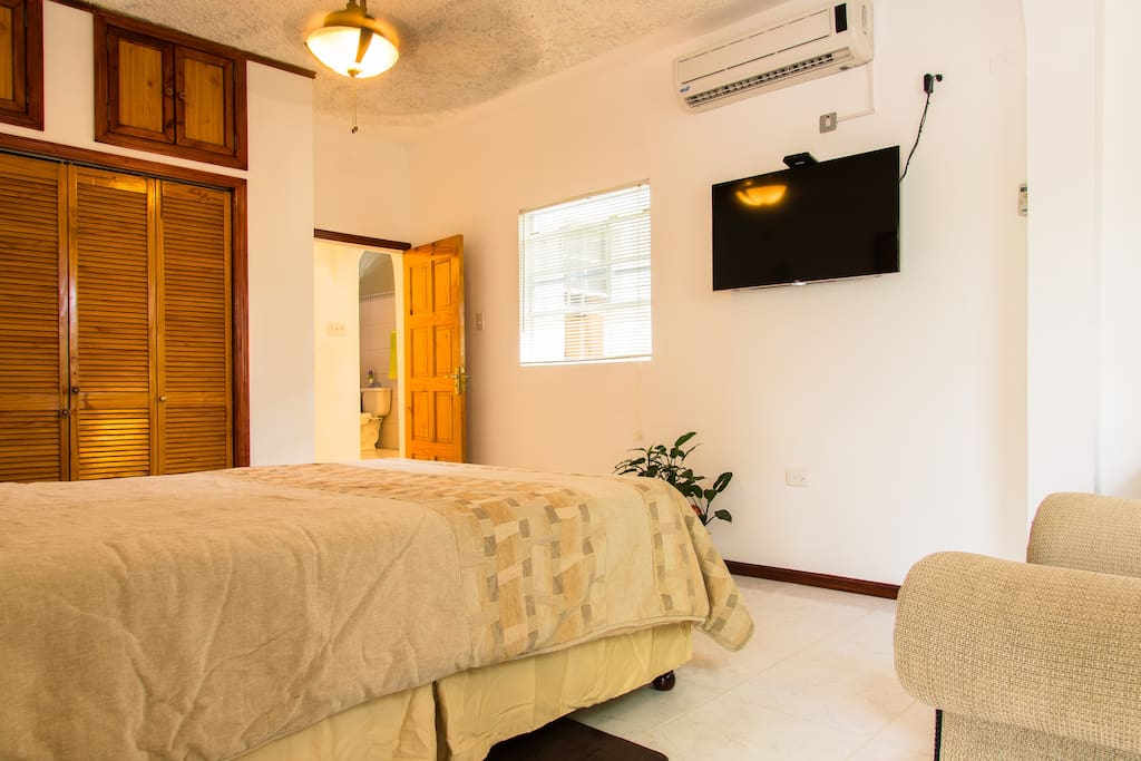 Bedroom view TV, AC, ceiling fan and Wifi at your convenience