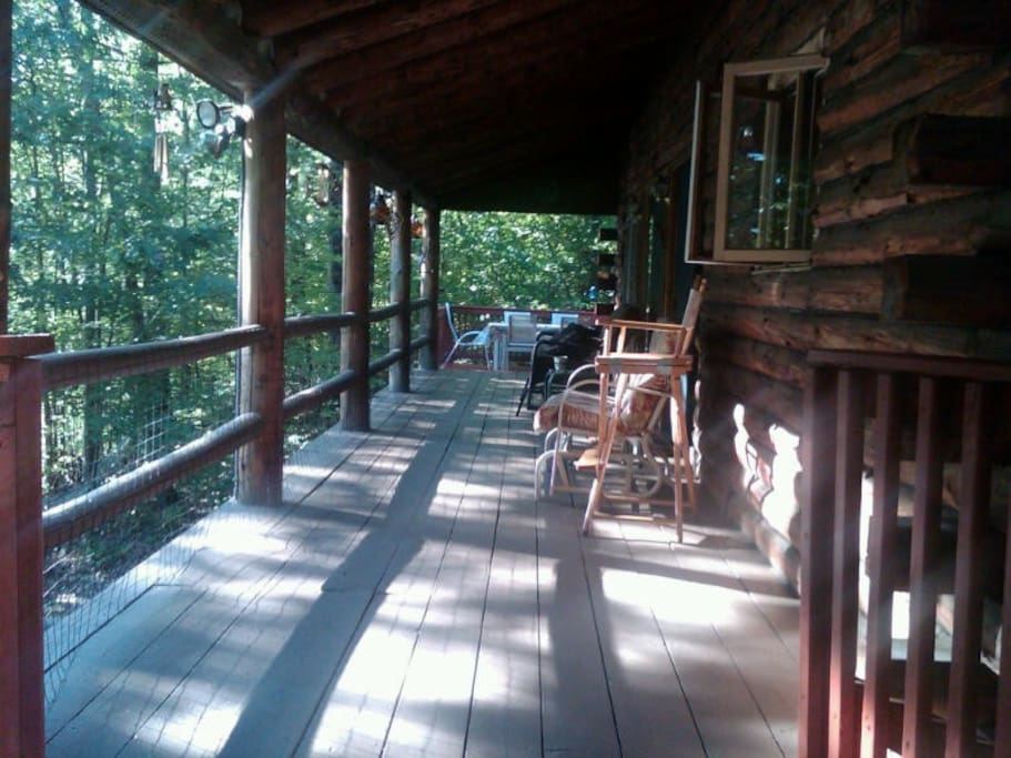 Covered Deck overlooking lake -- nothing better than having  cup of tea or coffee and reading a great book while looking out at the water!!