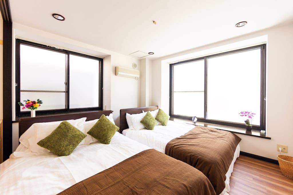 This bedroom also has 2 double sized beds. The bed making is inspired from a forest. Please sleep with a comfortable mattress. The bedrooms will welcome you in better standards than a hotel room.