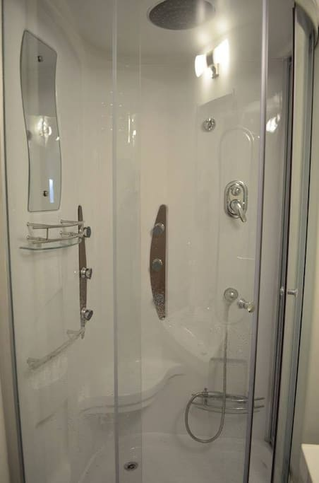 Stand-up shower in basement 1.5 bathroom.