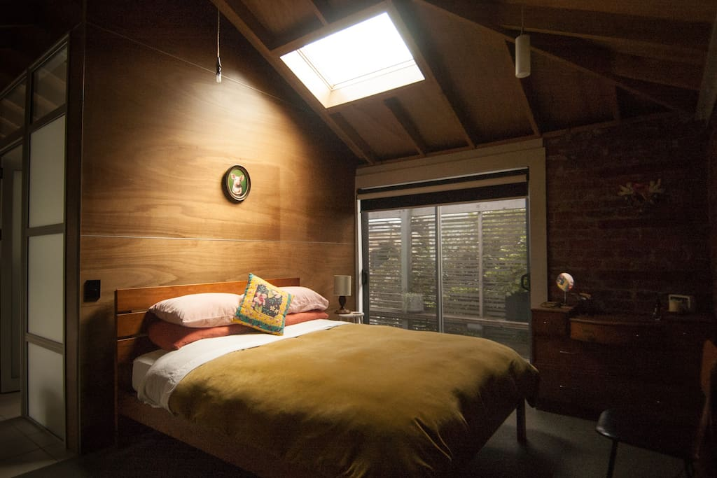 Bedroom skylights and a sliding door that opens up onto the balcony.