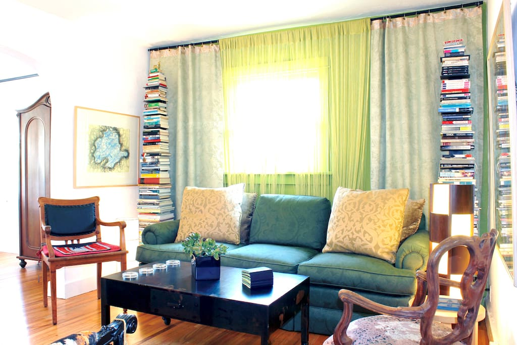 The living room has an incredibly comfy sofa. Just enough books to finish during your stay.