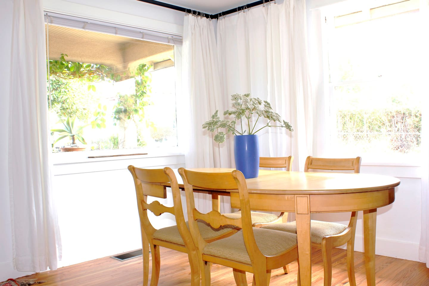 The dining room, with a view of the Santa Ynez mountains, opens onto the front porch.