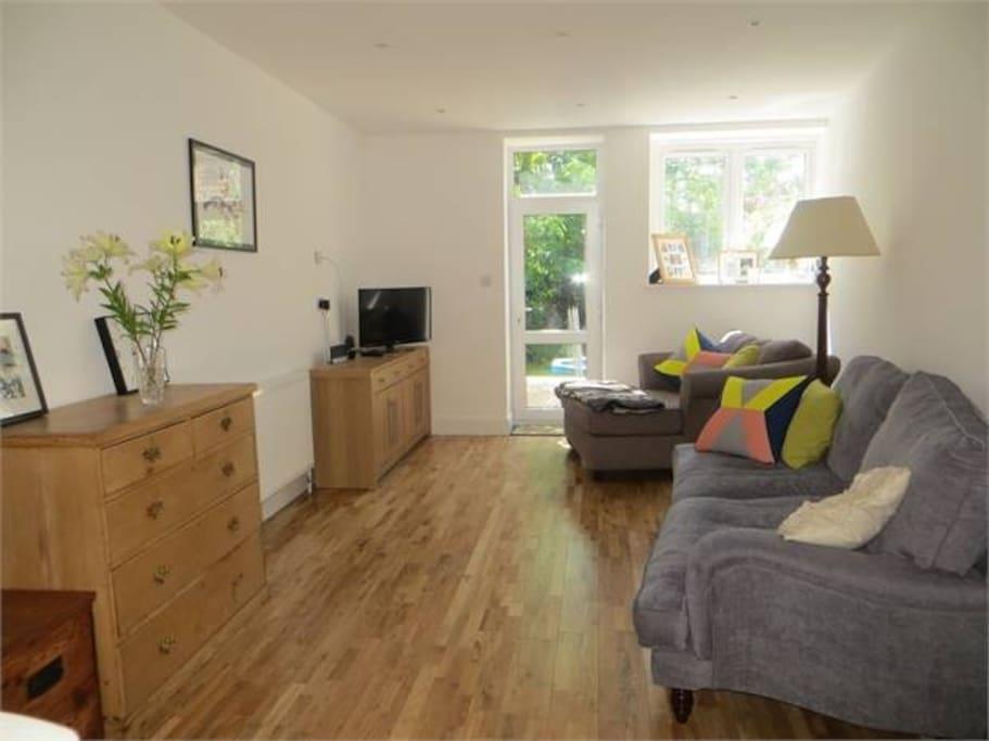 Open plan living area with door to garden