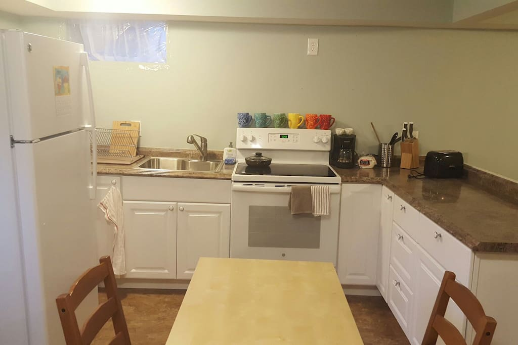 Fully equipped brand new kitchen with ceramic top stove, large fridge and all appliances you need, dishes, etc