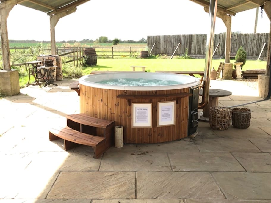 Our beautiful wood burning hot tub with views across open countryside