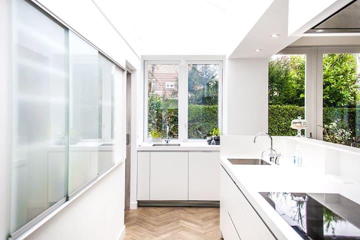 Kitchen (with Quooker, 2 ovens, Microwave, large induction cooking plate, full automatic espresso machine, dishwasher, large fridge & freezer)
