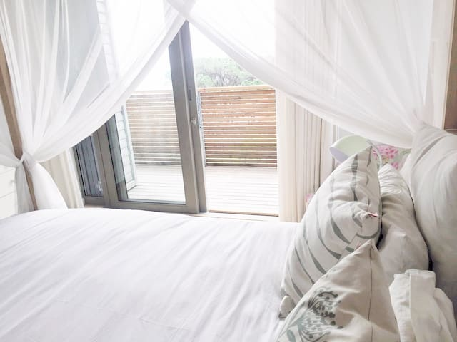Queen in bedroom 3 (upstairs) leading onto shared balcony with sea view.