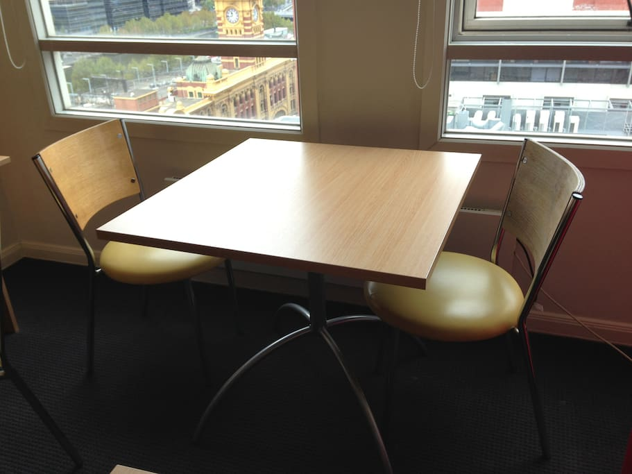 Small dinner table with view of the Yarra River and Flinders St Station