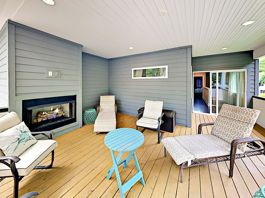 Gather around the gas fireplace on the back deck.