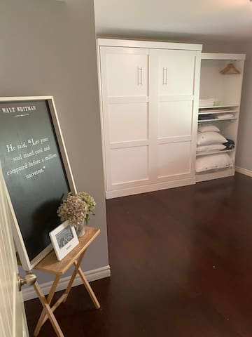 Murphy bed - office by day and bedroom by night!