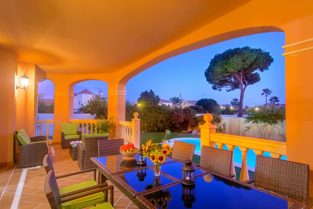 Terrace with dining area, lounge area, pool view