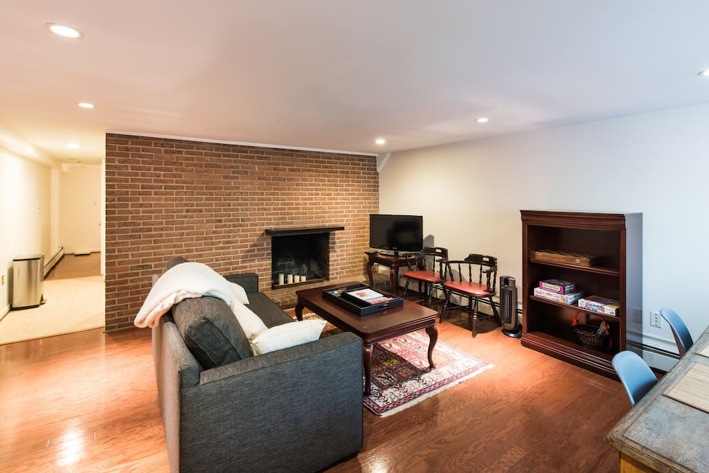 Living room with exposed brick, cable TV,  pull-out sofabed