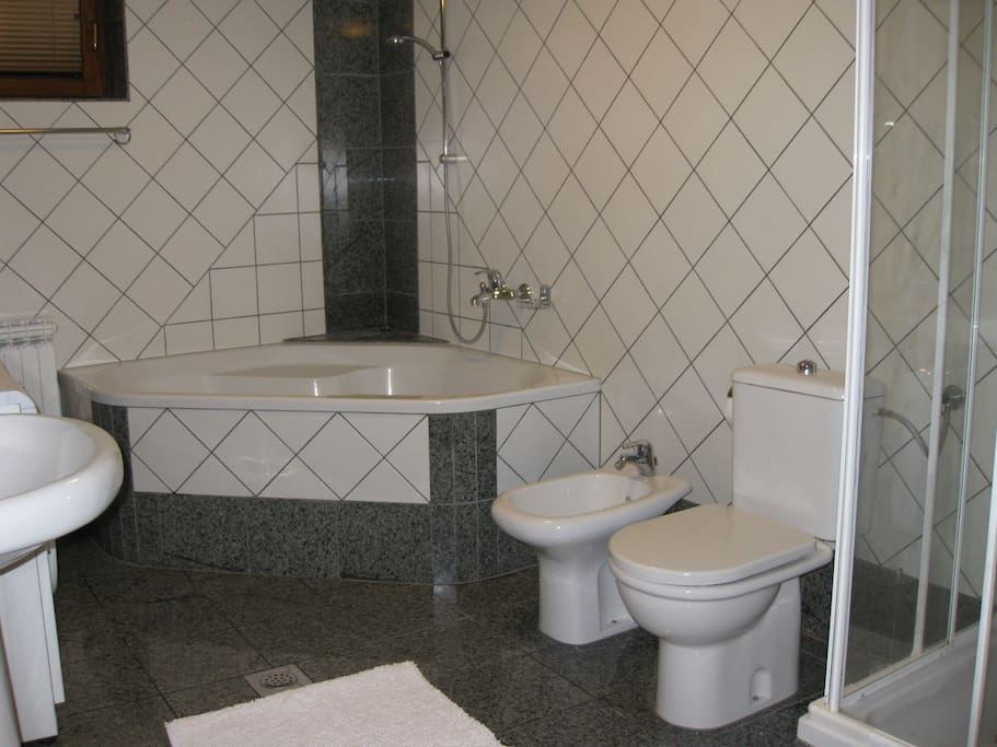 Large Bathroom with corner bath and separate shower
