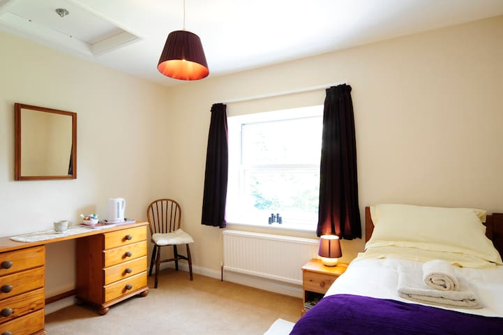 Large single room with plenty of storage and lovely views