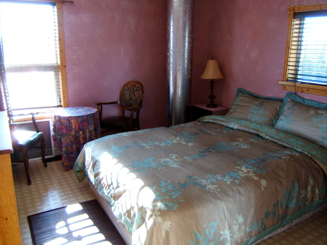 Pink Room with queen bed and chimney complete with magnetic poetry.