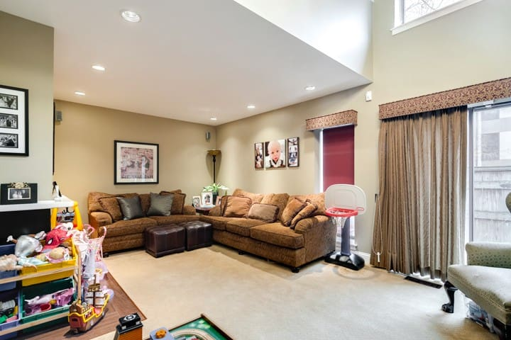 First floor living room. Access to private courtyard space, flatscreen TV, 2 couches.