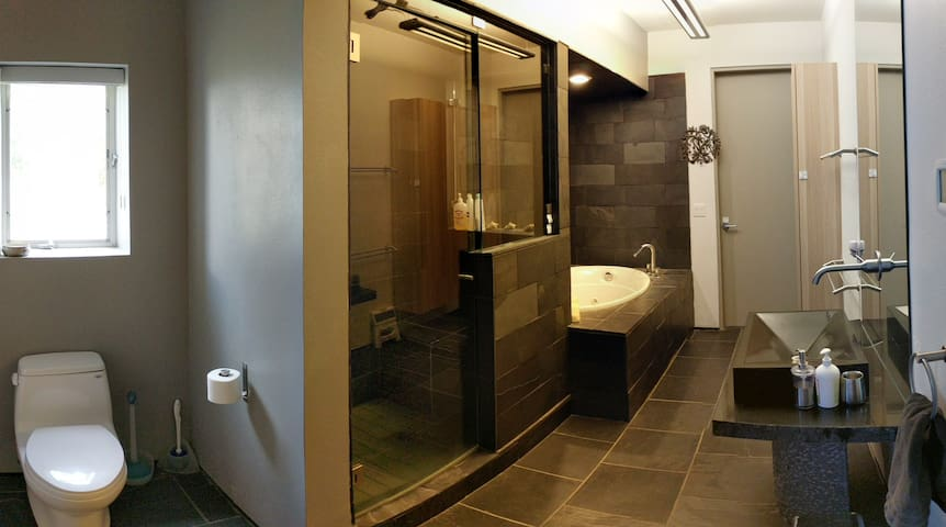 Bathroom:  Pamper yourself in your oversized black slate bathroom with in-floor radiant heating and jacuzzi tub, steam (or not) shower, black granite sink and grooming essentials (soap, shampoo, conditioner, bath salts, hair dryer, etc.) and towels.