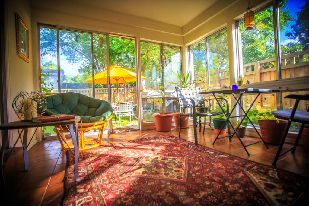 Sunroom, filled with plants, light, and love. Perfect place to read, eat and relax