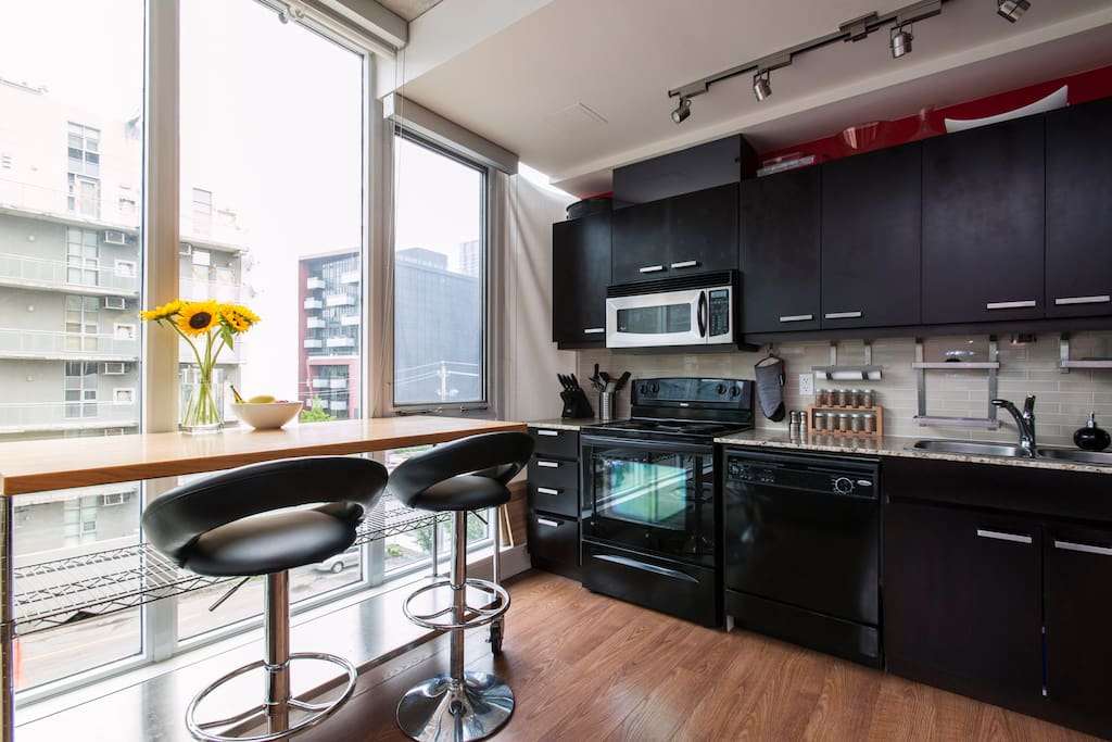 Modern kitchen with breakfast bar and everything you'll need to cook up a storm