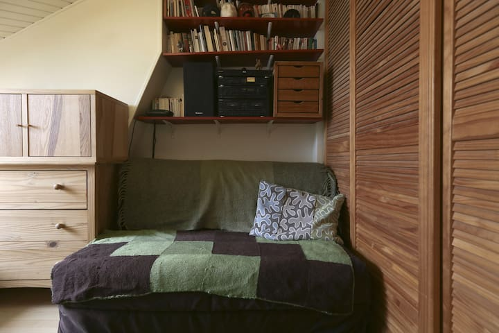Main room with a sofa. It is transformed into a double bed.