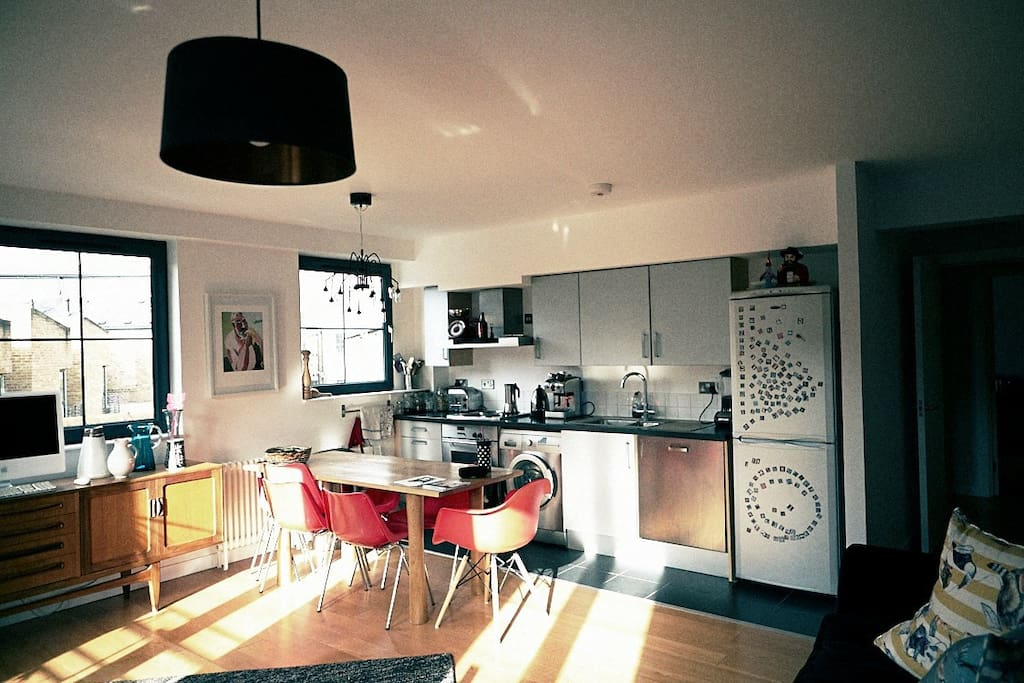 lovely airy living room, open plan kitchen, big dining table, with great views and fantastic sunsets