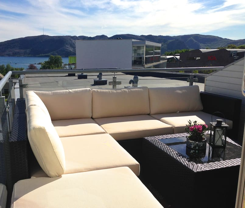 Enjoy your breakfast outside in the sun with the breathtaking fjord view