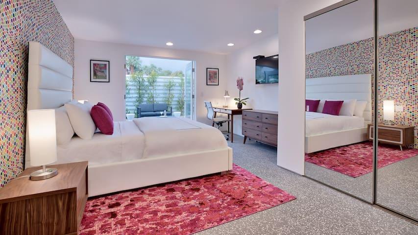 Bedroom #2:  The Pink room- Queen size bed, en-suite bathroom, desk, and private outdoor patio.
